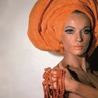 Veruschka wearing an orange towel on head