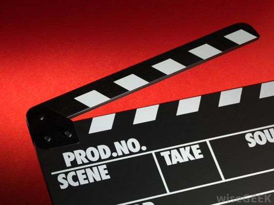 film-slate-against-red-background